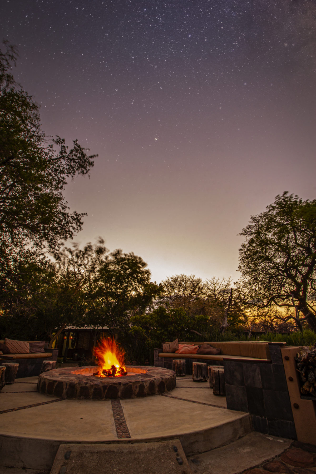 The fire roaring under the stars.